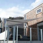 Sonnensegel wasserdicht schützt vor Sonne und Regen - hier Projekt in Langnau