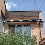 Sonnensegel aufgerollt unter Vordach